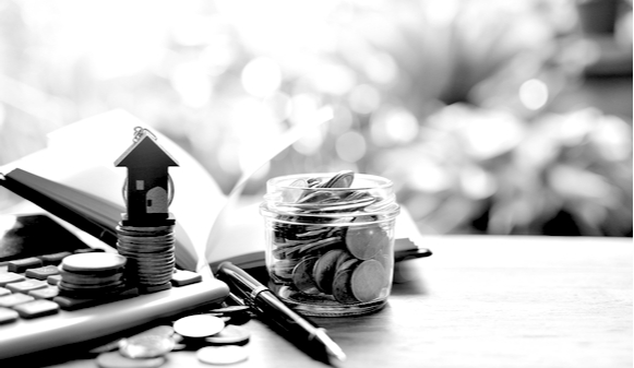 house model on coins for concept mortgage semi-commercial finance